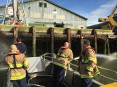 Richmond Fire Fighters testing out the SHA's emergency response vessel, the SHARC (Steveston Harbour Authority Response Craft)